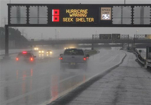 A sign warns commuters on the northbound side of the New Jersey Turnpike of the incoming Hurricane Irene as the state braced itself for the storm, Saturday, Aug. 27, 2011, Elizabeth, N.J. &#40;AP Photo&#47;Julio Cortez&#41; <span class=meta>(AP Photo&#47; Julio Cortez)</span>