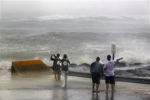 "<div class=""meta ""><span class=""caption-text "">People stand at the end of a street Saturday, Aug. 27, 2011, in Cape May, N.J., looking at a stormy Atlantic as Hurricane Irene arrives. Hurricane-force winds and drenching rains from Irene battered the North Carolina coast early Saturday as the storm began its potentially catastrophic run up the Eastern Seaboard. (AP Photo/Mel Evans) (AP Photo/ Mel Evans)</span></div>"