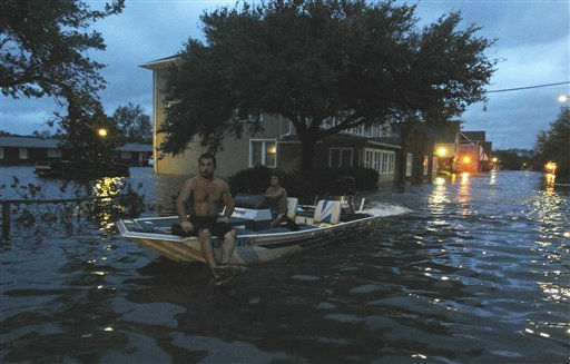 Two men use a boat to explore a street flooded by Hurricane Irene Saturday, Aug. 27, 2011 in Monteo, N.C. &#40;AP Photo&#47;John Bazemore&#41; <span class=meta>(AP Photo&#47; John Bazemore)</span>