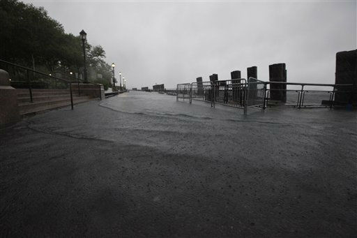 "<div class=""meta ""><span class=""caption-text "">Rising water breaches the sea wall at Battery Park, Sunday, Aug. 28, 2011 in New York. Hurricane Irene bore down on a dark and quiet New York early Sunday, bringing winds and rapidly rising seawater that threatened parts of the city. The rumble of the subway system was silenced for the first time in years, the city all but shut down for the strongest tropical lashing since the 1980s. (AP Photo/Mary Altaffer) (AP Photo/ Mary Altaffer)</span></div>"