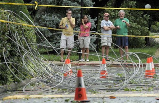 Residents of Annapolis, Md., look at downed power lines after Hurricane Irene, Sunday, Aug. 28, 2011. More than 4 million homes and businesses were without power Sunday morning as Hurricane Irene continued to roar up the East Coast and took aim at the New York City area and New England. Maryland, Delaware and Washington, D.C. had about three-quarters of a million outages combined.  &#40;AP Photo&#47;Susan Walsh&#41; <span class=meta>(AP Photo&#47; Susan Walsh)</span>