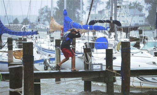 A person walks on a dock in Annapolis, Md., Sunday, Aug. 28, 2011, the after Hurricane Irene passed through. &#40;AP Photo&#47;Susan Walsh&#41; <span class=meta>(AP Photo&#47; Susan Walsh)</span>