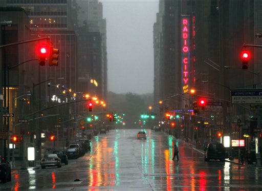 "<div class=""meta ""><span class=""caption-text "">Sixth Avenue near Radio City Music Hall is empty as Tropical Storm Irene hits in New York, on Sunday, Aug. 28, 2011. Seawater surged into the streets of Manhattan on Sunday as Irene slammed into New York, downgraded from a hurricane but still unleashing furious wind and rain. The flooding threatened Wall Street and the heart of the global financial network. (AP Photo/Mike Groll) (AP Photo/ Mike Groll)</span></div>"