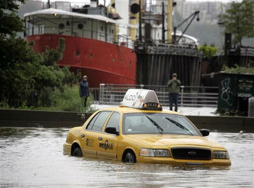 A New York City taxi is stranded in deep water on Manhattan?s West Side as Tropical Storm Irene passes through the city, Sunday, Aug. 28, 2011 in New York. Although downgraded from a hurricane to a tropical storm, Irene?s torrential rain couple with high winds and tides worked in concert to flood parts of the city. &#40;AP Photo&#47;Peter Morgan&#41; <span class=meta>(AP Photo&#47; Peter Morgan)</span>