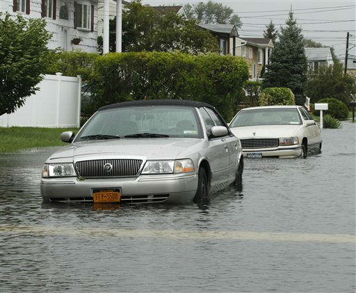 Parked cars are surrounded by ocean water after the storm surge of Hurricane Irene in Bellmore, N.Y., on Long Island, Sunday, Aug. 28, 2011. &#40;AP Photo&#47;Charles Krupa&#41; <span class=meta>(AP Photo&#47; Charles Krupa)</span>