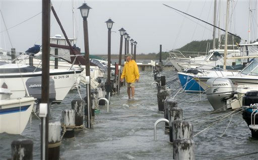 Robert Roy of Spray Beach, N.J., walks down one of the docks at the Spray Beach Yacht Club checking to make sure the boats are secure as the water in the bay rises from the tidal surge of Hurricane Irene on Long Beach Island, Sunday Aug. 28, 2011 in Spray Beach, N.J.  &#40;AP Photo&#47;Joe Epstein&#41; <span class=meta>(AP Photo&#47; Joe Epstein)</span>