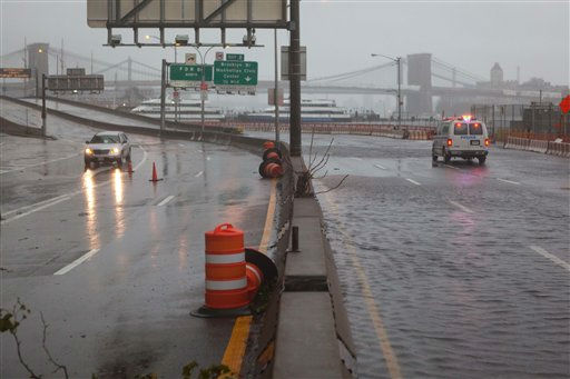 "<div class=""meta ""><span class=""caption-text "">Streets flooded at the southern tip of Manhattan as Tropical Storm Irene passes over the region, Sunday, Aug. 28th, 2011, in New York. Seawater surged into the streets of Manhattan on Sunday as Tropical Storm Irene slammed into New York, downgraded from a hurricane but still unleashing furious wind and rain. The flooding threatened Wall Street and the heart of the global financial network.  (AP Photo/John Minchillo) (AP Photo/ John Minchillo)</span></div>"