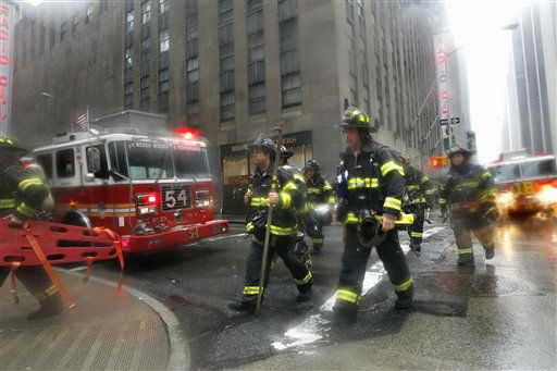 Firefighters make their way to a fire in a sub-basement in a 43-story building near Radio City in New York as Tropical Storm Irene passes through the city, Sunday, Aug. 28, 2011. The blaze is still under investigation and it is not known whether it was directly related to Irene.&#40;AP Photo&#47;Elise Amendola&#41; <span class=meta>(AP Photo&#47; Elise Amendola)</span>