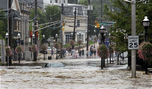 A car sits submerged on Main Street in Hightstown, N.J. Sunday, Aug. 28, 2011 after Peddie Lake overflowed from Hurricane Irene. Businesses and shops along the street were flooded.  Flood waters rose all across New Jersey on Sunday, closing roads from side streets to major highways as Hurricane Irene weakened and moved on, leaving 600,000 homes and businesses without power.&#40;AP Photo&#47;Jim Gerberich&#41; <span class=meta>(AP Photo&#47; Jim Gerberich)</span>