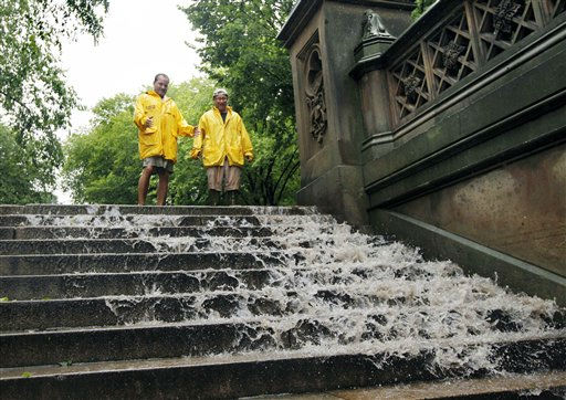Jimmy Kaplow, left, and David Korostoff, both of New York City, watch as water in New York City&#39;s Central Park flows down the steps toward the Bethesda Fountain as Tropical Storm Irene passes through the city, Sunday, Aug. 28, 2011. Although downgraded from a hurricane to a tropical storm, Irene&#39;s torrential rain coupled with high winds and tides worked in concert to flood parts of the city. &#40;AP Photo&#47;Elise Amendola&#41; <span class=meta>(AP Photo&#47; Elise Amendola)</span>