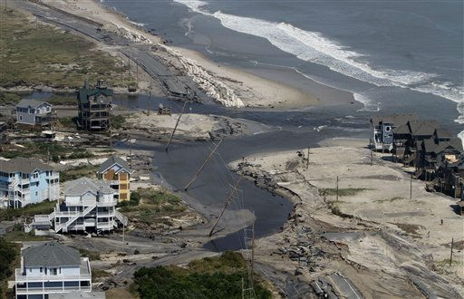 "<div class=""meta ""><span class=""caption-text "">The road is washed out on the north end of  route 12 on Hatteras Island, N.C., Sunday, Aug. 28, 2011.  Hurricane Irene swept through the area Saturday cutting the roadway in five locations. Irene caused more than 4.5 million homes and businesses along the East Coast to reportedly lose power over the weekend, and at least 11 deaths were blamed on the storm.  (AP Photo/Steve Helber) (AP Photo/ Steve Helber)</span></div>"