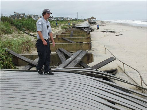 Special Police Officer Kevin Preston inspects a damaged section of boardwalk in Spring Lake, N.J. Sunday Aug. 28, shortly after Hurricane Irene had passed by. Preston says the storm surge damaged 1.5 miles of the 2-mile boardwalk, which is made of synthetic materials. &#40;AP Photo&#47;Wayne Parry&#41; <span class=meta>(AP Photo&#47; Wayne Parry)</span>