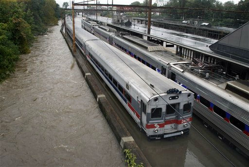 Two Southeastern Pennsylvania Transportation Authority trains sit in water on flooded tracks at Trenton train station Sunday, Aug. 28, 2011, in Trenton, N.J., as rains from Hurricane Irene are causing inland flooding of rivers and streams. &#40;AP Photo&#47;Mel Evans&#41; <span class=meta>(AP Photo&#47; Mel Evans)</span>
