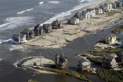 A flooded road is seen in Hatteras Island, N.C., Sunday, Aug. 28, 2011after Hurricane Irene swept through the area Saturday cutting the roadway in five locations. Irene caused more than 4.5 million homes and businesses along the East Coast to reportedly lose power over the weekend, and at least 11 deaths were blamed on the storm. &#40;AP Photo&#47;Jim R. Bounds&#41; <span class=meta>(AP Photo&#47; Jim R. Bounds)</span>