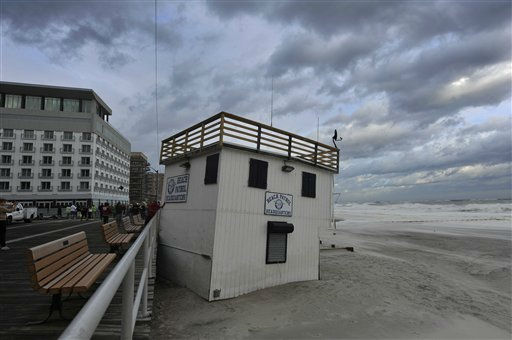 A Beach Patrol Headquarters used by the City of Long Beach lifeguards was lifted and moved to the boardwalk by the strong winds of Tropical Storm Irene as it swept through Long Island on Sunday, Aug. 28, 2011, in Long Beach, N.Y. Stripped of hurricane rank, Tropical Storm Irene spent the last of its fury Sunday, leaving treacherous flooding and millions without power _ but an unfazed New York and relief that it was nothing like the nightmare authorities feared. &#40;AP Photo&#47;Kathy Kmonicek&#41; <span class=meta>(AP Photo&#47; Kathy Kmonicek)</span>