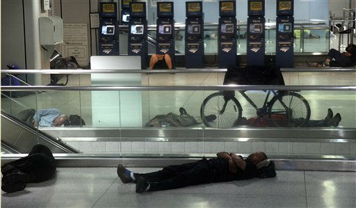 People sleep at Penn Station in New York, early Sunday, Aug. 28, 2011, as Hurricane Irene approaches the region. Public transportation in New York shut down around noon on Saturday. Irene has the potential to cause billions of dollars in damage all along a densely populated arc that includes Washington, Baltimore, Philadelphia, New York, Boston and beyond. At least 65 million people could be affected. &#40;AP Photo&#47;Chelsea Matiash&#41; <span class=meta>(AP Photo&#47; Chelsea Matiash)</span>