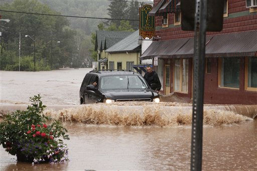 "<div class=""meta ""><span class=""caption-text "">A security guard hangs on the door of Gov. Andrew Cuomo's SUV in the middle of a flooded street Sunday, Aug. 28, 2011, in Margaretville, N.Y. Gov. Cuomo was riding in the SUV, and posted some photos of the heavy flooding on his flickr site. Torrential rains from Tropical Storm Irene forced hundreds in the Hudson Valley from their homes, caused widespread power outages, closed 137 miles of the state's main highway and swelled creeks and rivers to previously unseen levels. (AP Photo/Dick Sanford) (AP Photo/ Dick Sanford)</span></div>"