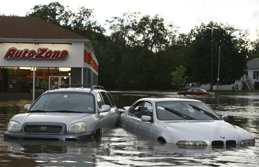 Flooded cars outside a store in Washingtonville, N.Y., Sunday Aug. 28, 2011 following heavy rains. Stripped of hurricane rank, Tropical Storm Irene spent the last of its fury Sunday, leaving treacherous flooding and millions without power. &#40;AP Photo&#47;Paul Kazdan&#41; <span class=meta>(AP Photo&#47; Paul Kazdan)</span>