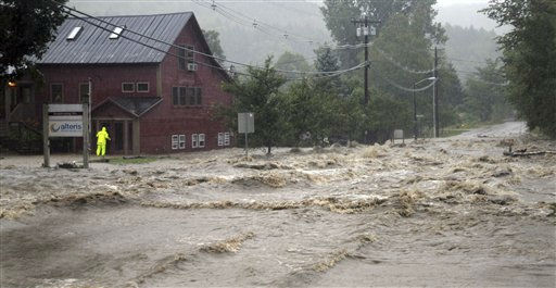 A person searches for anyone who may be occupying the building as raging flood waters from Tropical Storm Irene cross Route 100, closing the main road to traffic in Waitsfield, Vt., Sunday, Aug. 28, 2011. &#40;AP Photo&#47;Sandy Macys&#41; <span class=meta>(AP Photo&#47; Sandy Macys)</span>