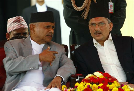 Nepalese President Ram Baran Yadav, left, chats with Baburam Bhattarai of the Communist Party of Nepal &#40;Maoist&#41; during swearing in of the later as the prime minister of Nepal in Katmandu, Nepal, Monday, Aug. 29, 2011. The deputy leader of Nepal&#39;s former Maoist rebels took the oath of office Monday as the new prime minister and began forming a government that will attempt to complete the country&#39;s contentious and long-delayed peace process. &#40;AP Photo&#47;Niranjan Shrestha&#41; <span class=meta>(AP Photo&#47; Niranjan Shrestha)</span>