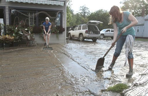 "<div class=""meta image-caption""><div class=""origin-logo origin-image ""><span></span></div><span class=""caption-text"">Nina Brennan, right, and Phyllis Berry clean mud from in front of the Proud Flower store in the aftermath of Tropical Storm Irene on Monday, Aug. 29, 2011 in Waterbury, Vt. Almost 50,000 Vermont utility customers were without power Monday, hundreds of roads were closed and a number of bridges destroyed by the ""epic"" flooding caused by by the remnants of Hurricane Irene.  (AP Photo/Toby Talbot) (AP Photo/ Toby Talbot)</span></div>"