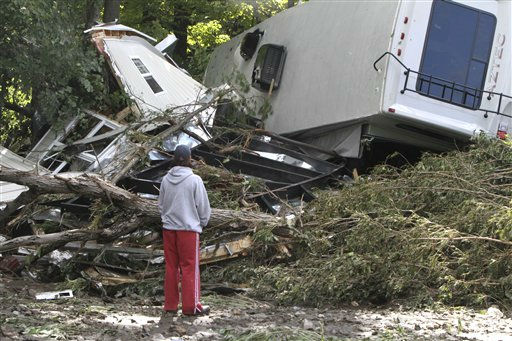 Lauren McTear looks over the remains of the trailer home owned by her boyfriend&#39;s parents on Monday, Aug. 29, 2011 in Berlin, Vt. The trailer was destroyed by a recreational vehicle which floated down the river into it. &#40;AP Photo&#47;Toby Talbot&#41; <span class=meta>(AP Photo&#47; Toby Talbot)</span>
