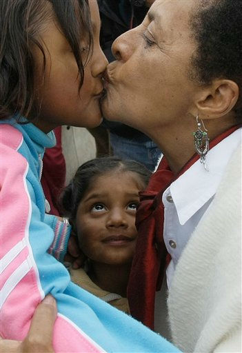 In this photo taken Aug. 29, 2011, Peru&#39;s Culture Minister Susana Baca kisses a girl during a visit to a school in San Luis de Canete, Peru, Monday. Baca, 67, is living testimony to Afro-Peruvians&#39; enduring struggle and she is determined to end the discrimination that made second-class citizens not just of blacks but also of Peru&#39;s indigenous. Baca became the Andean nation&#39;s first black Cabinet minister in July 2011. &#40;AP Photo&#47;Karel Navarro&#41; <span class=meta>(AP Photo&#47; Karel Navarro)</span>