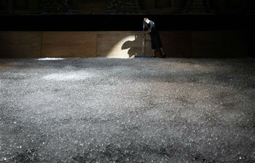 "<div class=""meta ""><span class=""caption-text "">A production crew member from the Imperial Ice Stars of Britain is framed by a stage light as he prepares an ice-skating rink made up of 14-tonnes of ice for their production ""Swan Lake on Ice"" which features former Russian Olympic ice-skating Medalists,  in Singapore, Monday Aug. 29, 2011. The 140 man-hours process starts Monday for the show which opens Tuesday. (AP Photo/Wong Maye-E) (AP Photo/ Wong Maye-E)</span></div>"