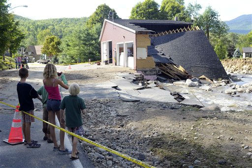 "<div class=""meta ""><span class=""caption-text "">People view the damaged Town of Keene Fire Department caused by Tropical Storm Irene in the Town of Keene , N.Y., Monday, Aug. 29, 2011. (AP Photo/Hans Pennink) (AP Photo/ Hans Pennink)</span></div>"