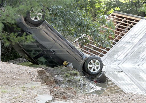 "<div class=""meta ""><span class=""caption-text "">A car lies upside down in the aftermath of Tropical Storm Irene on Monday, Aug. 29, 2011 in Waterbury, Vt. (AP Photo/Toby Talbot) (AP Photo/ Toby Talbot)</span></div>"