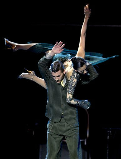 Argentina&#39;s Guido Palacios, bottom, and Florencia Zarate, top, perform during the finals of the 2011 Tango World Championship Stage category in Buenos Aires, Argentina, Tuesday, Aug. 30, 2011. &#40;AP Photo&#47;Victor R. Caivano&#41; <span class=meta>(AP Photo&#47; Victor R. Caivano)</span>