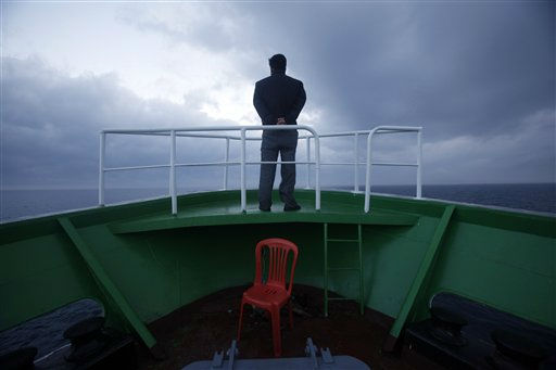 "<div class=""meta ""><span class=""caption-text "">In this photo taken Tuesday, Aug. 30, 2011, a man stands on the bow of the North Korean leisure boat the ""Mangyongbong"" during its trial cruise to Mount Kumgang resort from the port of Rason, North Korea. Since South Korean tourists have been barred from the luxury resort, known abroad as Diamond Mountain, North Korea has begun courting Chinese and other international tourists. (AP Photo/Ng Han Guan) (AP Photo/ Ng Han Guan)</span></div>"