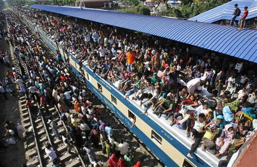Bangladeshi Muslims overcrowd a train to head home ahead of Eid al-Fitr in Dhaka, Bangladesh, Tuesday, Aug. 30, 2011. Eid al-Fitr marks the end of the fasting month of Ramadan. &#40;AP Photo&#47;Pavel Rahman&#41; <span class=meta>(AP Photo&#47; Pavel Rahman)</span>