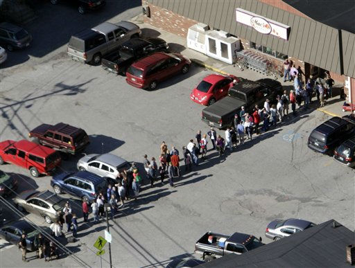 Residents stand in line outside a grocery store on Tuesday, Aug. 30, 2011 in Rochester, Vt. The town has been completely cut off since Tropical Storm Irene hit. &#40;AP Photo&#47;Toby Talbot&#41; <span class=meta>(AP Photo&#47; Toby Talbot)</span>