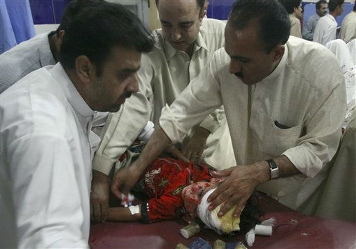 Pakistani medics give initial treatment to a child injured in the suicide bombing, at a local hospital in Quetta, Pakistan Wednesday, Aug. 31, 2011. A suicide car bomber attacked Shiite Muslims in southwestern Pakistan on Wednesday as they were heading home after morning prayers at the start of an Islamic holiday. The blast killed 10 people, officials said. &#40;AP Photo&#47;Arshad Butt&#41; <span class=meta>(AP Photo&#47; Arshad Butt)</span>