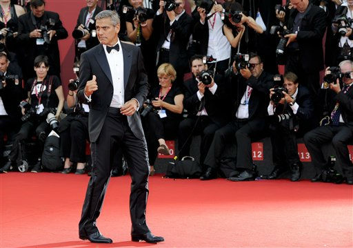 US actor George Clooney arrives on the red carpet for the premiere of his movie &#39;The Ides of March&#39;, which opens the 68th edition of the Venice Film Festival in Venice, Italy, Wednesday, Aug. 31, 2011. &#40;AP Photo&#47;Jonathan Short&#41; <span class=meta>(AP Photo&#47; Jonathan Short)</span>