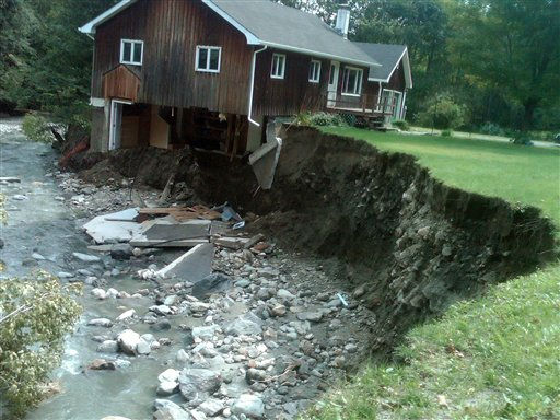 This photo taken Wednesday, Aug. 31, 2011 shows a house that was destroyed by hurricane-turned-tropical-storm Irene, in Rochester, Vt. Three days after the remnants of Irene deluged Vermont, this little town in the Green Mountains remained in the dark and unplugged Wednesday, its 1,000 residents leaning on each other _ and waiting. For food, for lights, for Internet connections, for telephones, for roads safe enough to drive in and out.   <span class=meta>(AP Photo&#47;John Curran)</span>