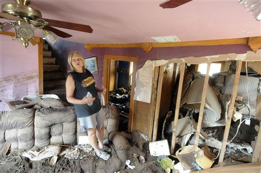 Pam Young talks about how the flood waters from of Tropical Storm Irene and how she and her two sons had to be rescued from their home on County Rt.7 in Prattsville, N.Y., Wednesday, Aug. 31, 2011. &#40;AP Photo&#47;Hans Pennink&#41; <span class=meta>(AP Photo&#47; Hans Pennink)</span>