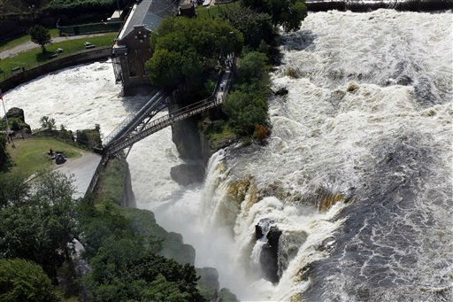 "<div class=""meta image-caption""><div class=""origin-logo origin-image ""><span></span></div><span class=""caption-text"">People stand on a foot bridge Thursday, Sept. 1, 2011, in Paterson, N.J.,  watching the Great Falls roar with water from Hurricane Irene. Flooding continues to hamper recovery efforts from Hurricane Irene in northern new Jersey while residents can begin seeking aid under a disaster declaration signed by President Barack Obama.  (AP Photo/Mel Evans) (AP Photo/ Mel Evans)</span></div>"
