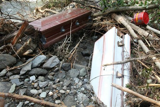 Caskets that were forced from the village cemetery ground by rushing waters lay in a river bed in Rochester, Vt. Thursday, Sept. 1, 2011. Rochester has been cut off from the rest of the world nearly all week, as roads in and out of town are impassable. &#40;AP Photo&#47;Robert Ray&#41; <span class=meta>(AP Photo&#47; Robert Ray)</span>