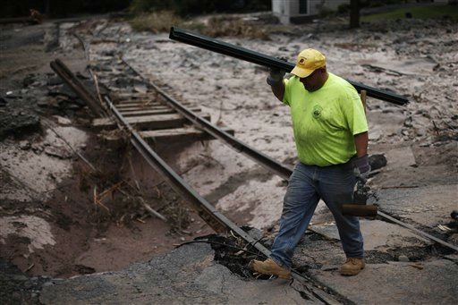 Wayne Crespino, with the Ulster County Department of Public Works, crosses washed out rail line in the aftermath of Tropical Storm Irene, Thursday, Sept. 1, 2011, in Phoenicia, N.Y.  &#40;AP Photo&#47;Matt Rourke&#41; <span class=meta>(AP Photo&#47; Matt Rourke)</span>