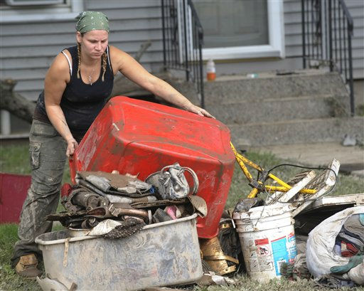 Frieda Derkowski of Schenectady, N.Y, who is seven months pregnant with her son helps her cousin clean up storm damage caused by Tropical Storm Irene in Rotterdam Junction, N.Y., Thursday, Sept. 1, 2011.   Utility companies continue to bring New York electricity customers back on line, but almost 182,000 are still blacked out four days after Irene pounded the state with drenching rains and high winds. &#40;AP Photo&#47;Hans Pennink&#41; <span class=meta>(AP Photo&#47; Hans Pennink)</span>
