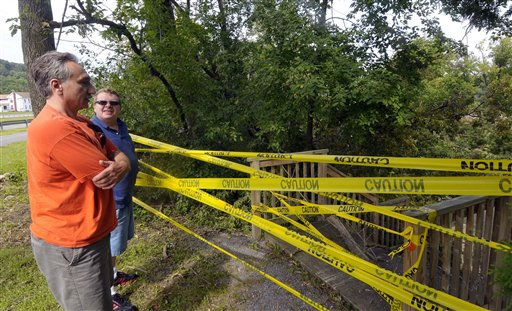 Dave Melideo of Glenville, N.Y.,left, and James Gilliland of Schenectady, N.Y., find their hiking trail at Kiwanis Park closed after flooding caused by Tropical Storm Irene in Rotterdam Junction, N.Y., Thursday, Sept. 1, 2011.   Utility companies continue to bring New York electricity customers back on line, but almost 182,000 are still blacked out four days after Irene pounded the state with drenching rains and high winds.  &#40;AP Photo&#47;Hans Pennink&#41; <span class=meta>(AP Photo&#47; Hans Pennink)</span>