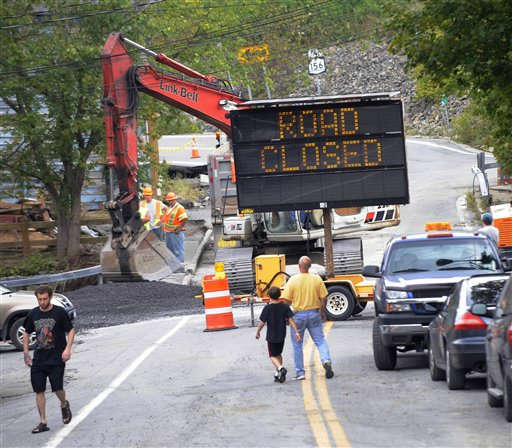 "<div class=""meta ""><span class=""caption-text "">People watch a section of road being repaired along Rt. 156 damaged by Tropical Storm Irene in The Town of Berne, N.Y., Thursday, Sept.1, 2011.  Utility companies continue to bring New York electricity customers back on line, but almost 182,000 are still blacked out four days after Irene pounded the state with drenching rains and high winds. (AP Photo/Hans Pennink) (AP Photo/ Hans Pennink)</span></div>"