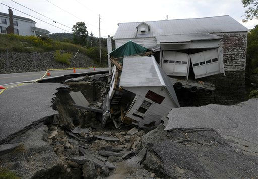 "<div class=""meta ""><span class=""caption-text "">Road and building damage along Rt. 156  caused by Tropical Storm Irene in The Town of Berne, N.Y., Thursday, Sept.1, 2011.   Utility companies continue to bring New York electricity customers back on line, but almost 182,000 are still blacked out four days after Irene pounded the state with drenching rains and high winds.  (AP Photo/Hans Pennink) (AP Photo/ Hans Pennink)</span></div>"