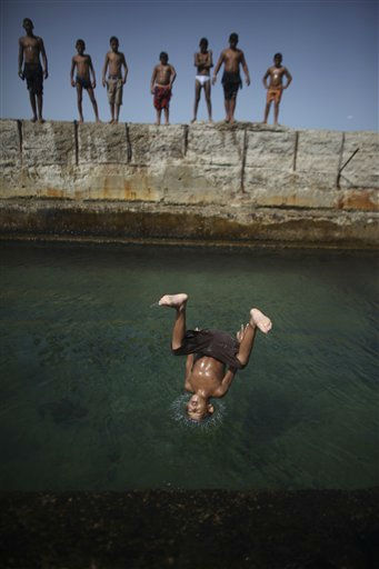 Ramadan Bofez, 9, jumps to the sea in Tripoli, Libya, Thursday, Sept. 1, 2011. &#40;AP Photo&#47;Alexandre Meneghini&#41; <span class=meta>(AP Photo&#47; Alexandre Meneghini)</span>