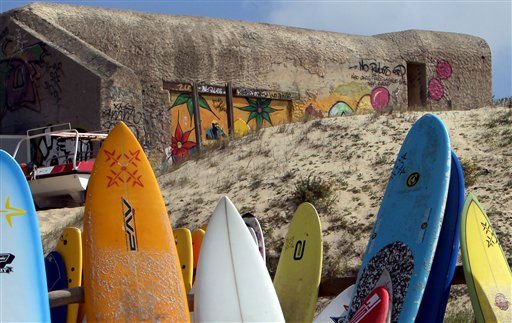 "<div class=""meta ""><span class=""caption-text "">Surf boards are seen near a blockhaus, part of the Atlantic Wall, on the beach La Caserne in Seignosse, southwestern France, Thursday, Aug.11, 2011. The Atlantic Wall was an extensive system of coastal fortifications built by Nazi Germany between 1942 and 1944 along the western coast of Europe as a defense against an anticipated Allied invasion of the mainland continent. (AP Photo/Bob Edme) (AP Photo/ Bob Edme)</span></div>"