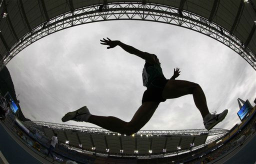 "<div class=""meta ""><span class=""caption-text "">South Korea's Kim Deok-hyeon competes in the qualification for the Men's Triple Jump at the World Athletics Championships in Daegu, South Korea, Friday, Sept. 2, 2011. (AP Photo/David J. Phillip) (AP Photo/ David J. Phillip)</span></div>"