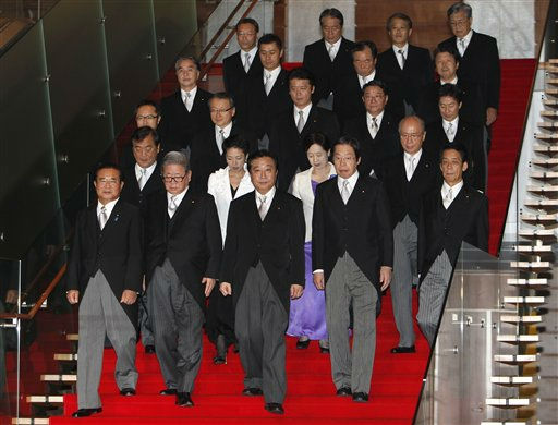 "<div class=""meta ""><span class=""caption-text "">Japan's new Prime Minister Yoshihiko Noda, front row center, leads his Cabinet members for an official photo session following their first Cabinet meeting at the prime minister's official residence in Tokyo Friday, Sept. 2, 2011. (AP Photo/Shizuo Kambayashi) (AP Photo/ Shizuo Kambayashi)</span></div>"