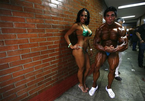 "<div class=""meta ""><span class=""caption-text "">Contestants pose for pictures backstage during the Mr and Miss Mexico bodybuilding contest in Mexico City, Sunday, Sept. 4, 2011. (AP Photo/Marco Ugarte) (AP Photo/ Marco Ugarte)</span></div>"